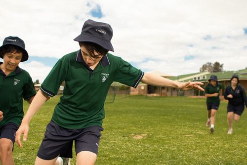 Tyndale Christian School students run around the school grounds