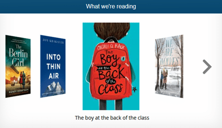 This image shows an example of a carousel of books on the Accessit Web App which displays four book covers with the main one of a boy with a red backpack facing with his back towards us.